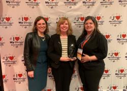 Ellen Stroud, Frances Newman, and Nicole Adams with the Award
